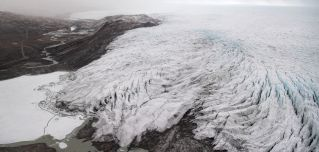 A photo taken during a helicopter tour with U.S. Secretary of State Antony Blinken shows ice receding from a glacier near Kangerlussuaq, Greenland, on May 20, 2021.