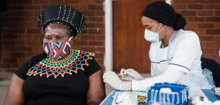 A woman receives a jab of a COVID-19 vaccine in Durban, South Africa, on Sept. 24, 2021.