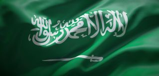 An image shows the national flag of Saudi Arabia.