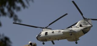 A U.S. military helicopter flies toward the Green Zone in Kabul, Afghanistan, on July 1, 2021.