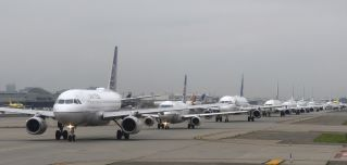 Airplanes await permission to take off at on July 13, 2021, at Newark Liberty International Airport.