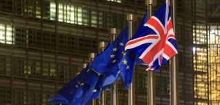 EU and British flags Dec. 9, 2020, in front of the headquarters of the European Commission in Brussels.