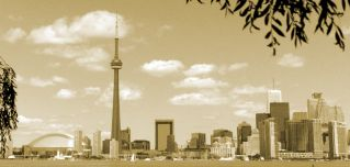 The iconic CN Tower anchors Toronto's skyline on a clear day.