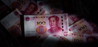 A photo illustration shows Chinese 100 yuan notes in Beijing on Jan. 14, 2020.