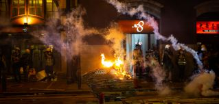 A burning cart is seen during a demonstration in the area of Sheung Wan on July 28, 2019, in Hong Kong.