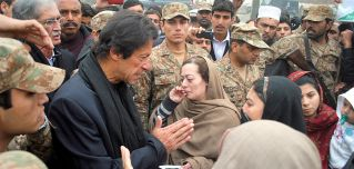 Pakistani Prime Minister Imran Khan meets with family members of schoolchildren killed in a 2014 massacre by Taliban militants in Peshawar.