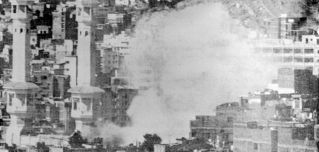 """Mecca's Grand Mosque burns in November 1979 during a siege by several hundred Muslim militants seeking to overthrow the House of Saud. The two-week siege moved the Saudi royal family to counter claims it was not """"Islamic enough"""" by fostering an even closer relationship with Wahhabi clerics and their followers."""