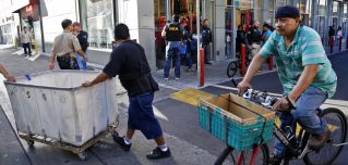 In this photo, authorities raid a fashion storefront in downtown Los Angeles on Sept. 10, 2014, as part of an investigation into the alleged laundering of narcotics profits by Mexican drug cartels.