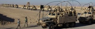 A line of U.S. Army armored vehicles lines up at Camp Virginia near the capital of Kuwait as soldiers pull out of service in Iraq.