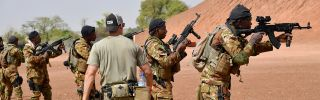 A U.S. Army trainer instructs Malian soldiers on April 12, 2018, during an anti-terrorism exercise at the Kamboinse general Bila Zagre military camp near Ouagadougou, Burkina Faso.