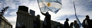 Man waves the Argentine flag