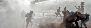 Demonstrators clash with riot police following a protest against the Chilean government Dec. 18, 2019, in Santiago, Chile.