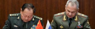 Russian Defense Minister Sergei Shoigu, right, and Zhang Youxia, vice chairman of China's Central Military Commission, sign documents boosting military ties in Moscow on Sept. 4, 2019.