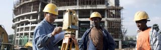 A Chinese construction worker with Ethiopian workers at the new African Union Buildings on November 17, 2010 in Addis Ababa, Ethiopia.