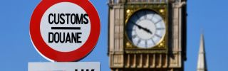 A model of a customs road sign is seen at the mock U.K.-EU border, with a mock Big Ben in the background, at the Mini-Europe theme park in Brussels, Belgium, on May 20, 2020.