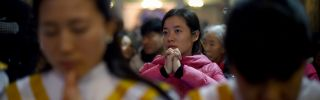 Chinese worshippers attend Christmas Eve Mass at a Catholic church in Beijing during 2015.