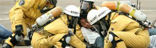 Members of the Tokyo Fire Department rescue a man in the role of the injured during an anti-terrorism exercise conducted by the Tokyo Metropolitan Government.