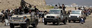 Houthi-allied tribesmen ride trucks mounted with machine guns on the outskirts of Sanaa, Yemen, on July 8, 2020.