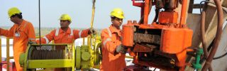 Indian technicians work on the country's first shale-gas exploratory well at ONGC Ankleshwar Asset near Jambusar, 2013.