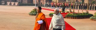 Indian Prime Minister Narendra Modi (R) walks with Bhutanese Prime Minister Lotay Tshering during a ceremonial reception at the Presidential Palace in New Delhi on Dec. 28, 2018.
