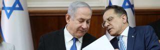 Israeli Prime Minister Benjamin Netanyahu, left, speaks with Cabinet Secretary Tzachi Braverman during a weekly Cabinet meeting in Jerusalem on Dec. 1, 2019.