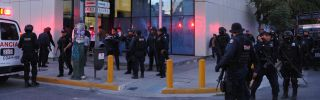 Members of Mexican federal police stand guard in the main entrance of the El Siglo de Torreon Newspaper, in Torreon, Coahuila State, on February 26, 2013.
