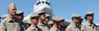 Russian air force personnel stand in front of a Tupolev Tu-160 long-range strategic bomber upon landing at Simon Bolivar International Airport, north of Caracas, Venezuela, on Dec. 10, 2018.