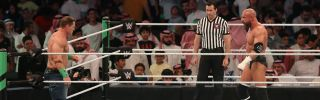 John Cena (L) competes with Triple H during the World Wrestling Entertainment (WWE) Greatest Royal Rumble event in Jeddah on April 27.