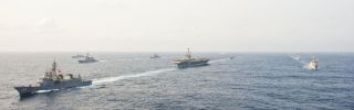 hips from the USS George Washington Carrier Strike Group, the Japanese Maritime Self-Defense Force and the Republic of Korea navy are underway during a trilateral exercise, East China Sea, 2012.