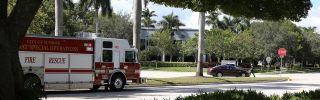 The bomb squad of the Broward County Sheriff's Office uses a robotic vehicle to investigate a suspicious package at the building housing an office for U.S. Rep. Debbie Wasserman Schultz (D-FL)  in Sunrise, Florida, on Oct. 24, 2018.