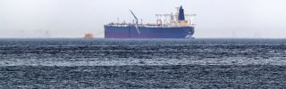 """A picture taken on May 13, 2019, shows the crude oil tanker Amjad, one of two Saudi tankers that were reportedly damaged in mysterious """"sabotage attacks,"""" off the coast of the Gulf emirate of Fujairah."""