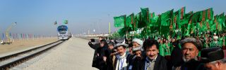People gather at the Imamnazar customs point during a ceremony for the opening of the first section of a $2 billion railway link between Turkmenistan and Afghanistan.