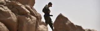An Algerian soldier on patrol in the Tamanrasset Desert south of Algiers.