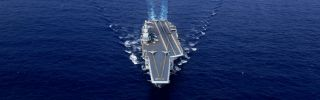 This photo taken on April 18 shows China's sole operational aircraft carrier, the Liaoning, during a drill at sea.