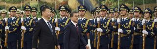 South Korean President Moon Jae In (R) and Chinese President Xi Jinping (L) during a welcome ceremony in Beijing, China, on Dec. 14, 2017. Despite attempts to heal old wounds and build a more supportive partnership during Moon's visit to China, Seoul and Beijing find themselves with increasingly divergent priorities.