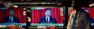 Televisions on display at an electronics store in Hong Kong are all tuned to Chinese President Xi Jinping's address to the 19th Chinese Communist Party Congress on Oct. 18, 2017.