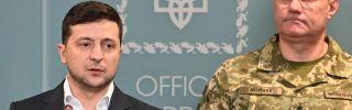 Ukrainian President Volodymyr Zelenskiy speaks following an outbreak of violence with pro-Russian separatists in eastern Ukraine on Feb. 18, 2020. Ruslan Khomchak, the commander of Ukraine's armed forces, stands behind Zelenskiy.