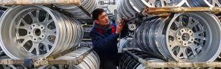A Chinese worker checks wheels on Jan. 28, 2019, at a factory in Lianyungang, Jiangsu province.