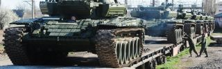Russian soldiers unload modified T-72 tanks at the Gvardeyskoe railway station near the Crimean capital of Simferopol on March 31, 2014.