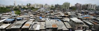 In this 2007 photograph, office blocks and residential buildings tower over the notorious slum colony of Dharavi in Mumbai, India.