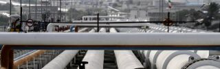 Export oil pipelines are pictured at an oil facility on Iran's Kharg Island on Feb. 23, 2016.