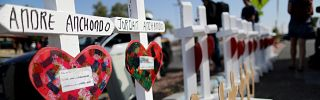 Handmade crosses memorialize the victims of a mass shooting in El Paso, Texas, on Aug. 5, 2019.
