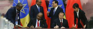 Chinese Premier Li Keqiang and then-Ethiopian Prime Minister Hailemariam Desalegn attend a signing ceremony at the Great Hall of the People in Beijing on May 12, 2017.