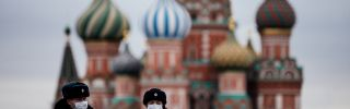 Russian police officers patrol Red square in front of Saint Basil's Cathedral in Moscow