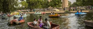 Families in New Dehli take a boat ride during a heat wave.