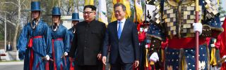 In this photograph, North Korean leader Kim Jong Un, left, and South Korean President Moon Jae In walk together on April 27, 2018, after meeting in Panmunjom for the first inter-Korean summit since 2007.