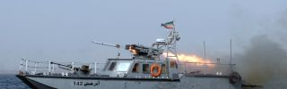 """An Iranian war-boat fires a missile during the """"Velayat-90"""" navy exercises in the Strait of Hormuz in southern Iran."""