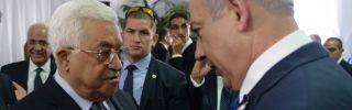 Israeli Prime Minister Benjamin Netanyahu shakes hands with Palestinian Authority President Mahmoud Abbas.