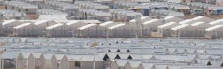 Prefabricated metal homes are seen at the Azraq camp for Syrian refugees in northern Jordan on January 30, 2016.