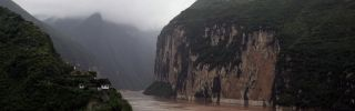 A boat sails at the Kuimen Gate of Qutang Gorge.